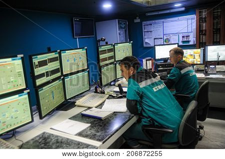 Tobolsk Russia - July 15. 2016: Sibur company. Central control panel of Tobolsk Polymer plant. Industrial workers in control room