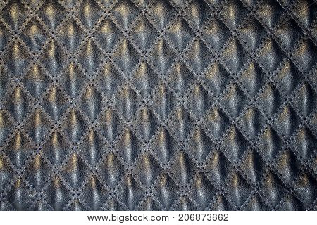 great texture of dark blue quilted skin