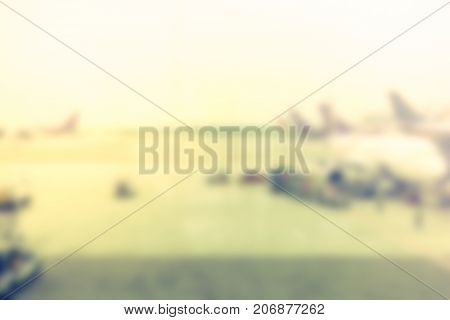 Blurred Background Looking Through Terminal Window To See Airplane At Airport