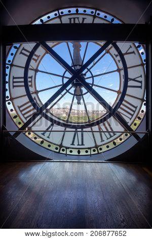 PARIS, FRANCE -JUNE 11, 2017: Famous clock in the Orsay Museum with Sacr -C ur in distance, Paris, France.