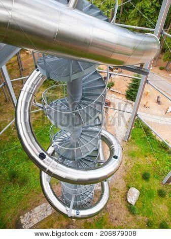 LIPNO NAD VLTAVOU, CZECH REPUBLIC - 26 September 2017. Spiral slide tube in the middle of The Treetop Walkway, Lipno nad Vltavou, Czech Republic.