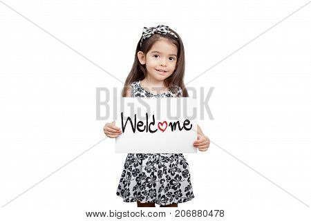 Business welcome concept Cute girl holding a welcome sign standing on white background. Cute mixed race girl half Thai half English model 3 years old.