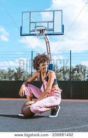 Woman With Basketball At Sports Court