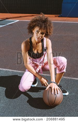 African-american Woman With Basketball At Sports Court