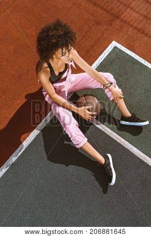 African-american At Sports Court With Basketball