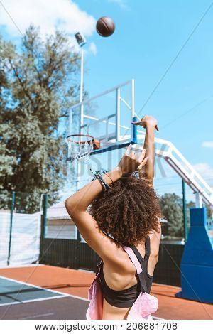 African-american Throwing Basketball