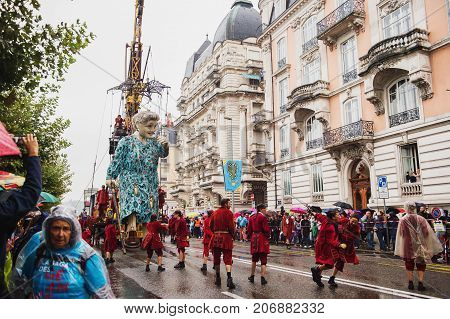 Geneva, Switzerland - September 30 2017: The grandmother giant walking in the street of Geneva by Royal De Luxe company Nantes France