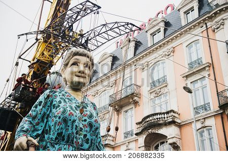 Geneva Switzerland - September 30 2017: The grandmother giant walking in the street of Geneva by Royal De Luxe company Nantes France