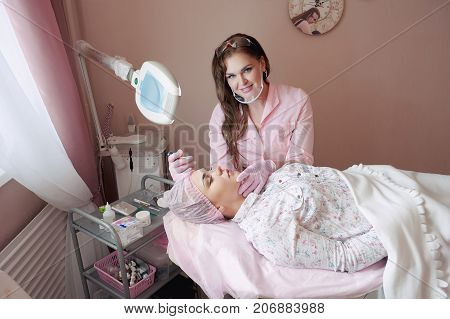 A Young Woman Lies And Gets A Make-up Of Her Eyebrows In A Beauty Salon. The Use Of Permanent Makeup