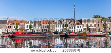 HAARLEM, NETHERLANDS - SEPTEMBER 03, 2017: Panorama of ships and houses at a canal in Haarlem Netherlands