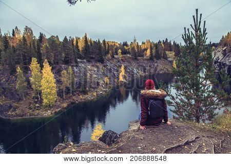 Girl Tourist Looks At Mountain Lake In Marble Canyon.