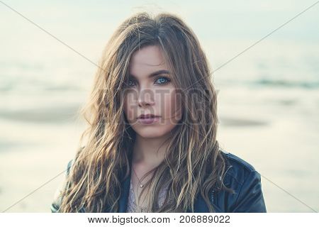 Magnificent Woman with Curly Hairstyle and Makeup on Nature Background