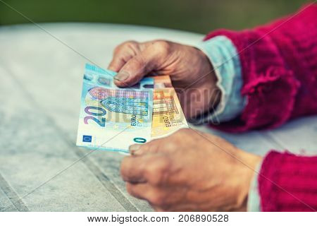 Pensioner Man Holding In Hands Euro Banknotes