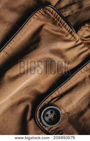 stylish female coat. clothes with buttons close-up