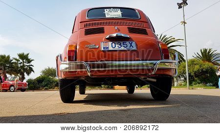 Menton France - September 9 2017: Old Red Fiat 500 L (Rear View) Parked on the Esplanade Francis Palmero in the City of Menton on the French Riviera