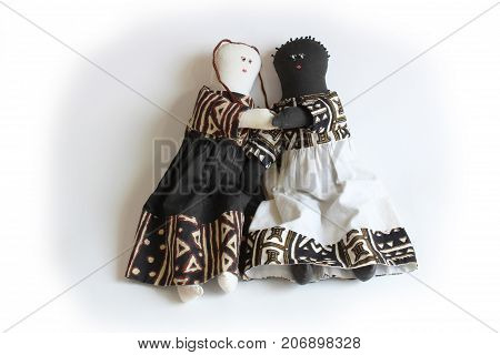 Black and white doll holding hands concept racial harmony, inclusion, isolated on white