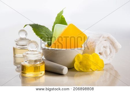 Handmade Ayurvedic Soap with bath and spa accessories. Fresh flowers, precious oils, mortar and towels
