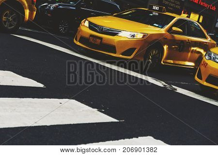 NEW YORK NY - September 2nd 2017: traffic in New york with yellow cabs waiting for green light at a pedestrian crossing