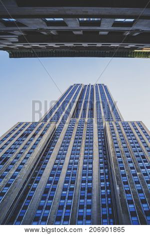 NEW YORK NY - September 4th 2017: perspective of the Empire State Building shot from right up