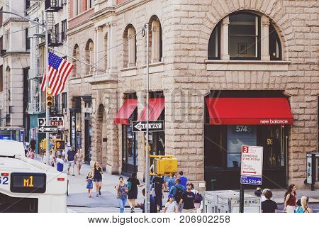 NEW YORK NY - September 4th 2017: traffic and unidentified people on the iconic Fifth Avenue in Manhattan