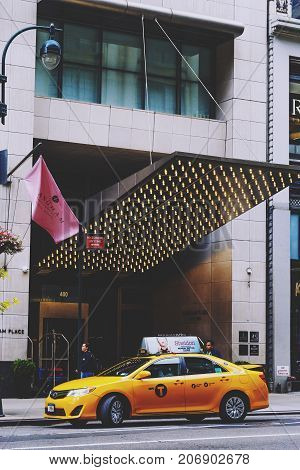 NEW YORK NY - September 9th 2017: yellow cab in front of an elegant hotel on the 5th Avenue in Manhattan