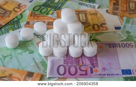 Salt White Granules On The Background Of Euro Banknotes