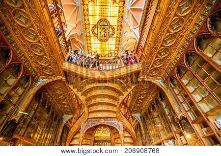 Oporto, Portugal - August 13, 2017: the spectacular ceiling made of painted chalk from Libreria Lello and Irmao, the second oldest library in Portugal famous for the Harry Potter film. Horizontal shot