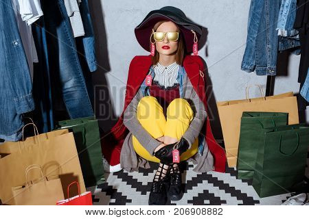 Woman In Clothes With Sale Tags