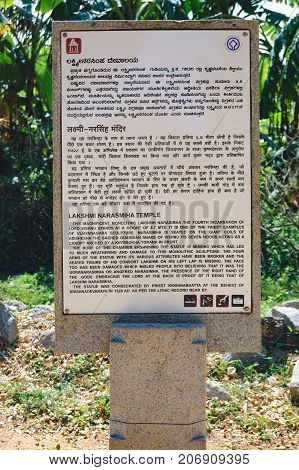 Hampi, India - November 20, 2012: Signpost for tourists about the ancient ruins of Hampi - Lakshmi Narasimha Temple in Hampi, Karnataka, India.