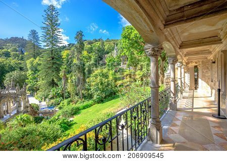 Veranda of Regaleira Palace and beautiful landscape in Sintra, Portugal. Sunny day, blue sky.