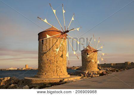 Two traditional windmill in Mandraki port of RhodesGreece
