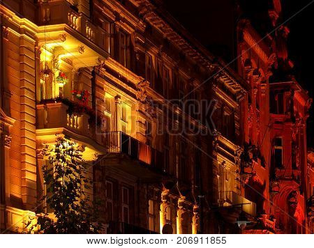 Discreet charm of the history of the city of Lodz. Lodz, Poland - September 29, 2017 Historical tenement houses on Piotrkowska Street illuminated during the Light Art Festival in Lodz.