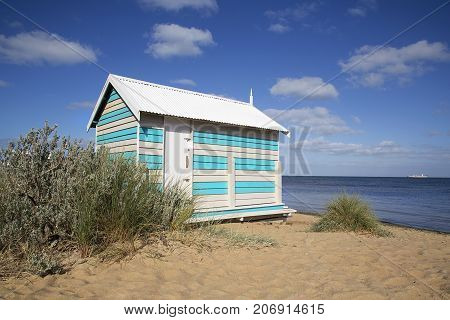 A beautiful bathing hut on Melbourne's Brighton Beach with fabulous blue skies and ocean background.