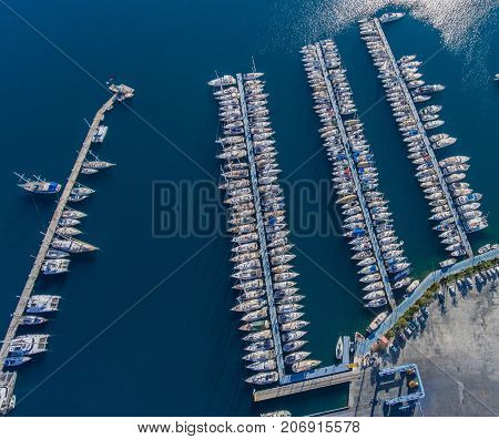 Aerial View Of The  Marina. Many Boats Moored To Floating Pontoons
