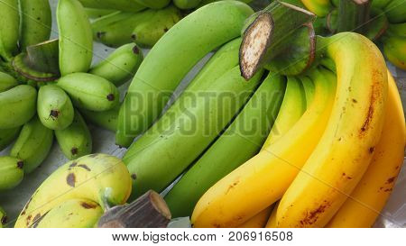 Thai Cavendish banana and Pisang Awak on sale at street shop Macro and close up photo full frame.
