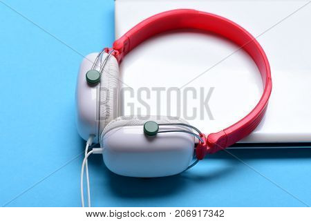 Electronics Isolated On Blue Background. Music And Digital Equipment Idea