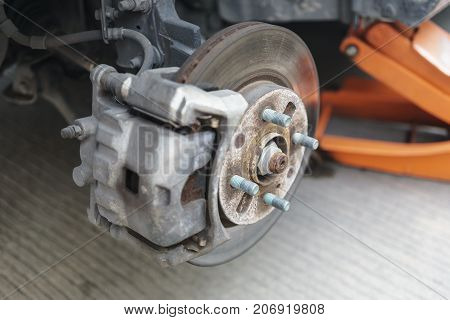 Detail of disc brake system of a car without the wheel to recap the tire.