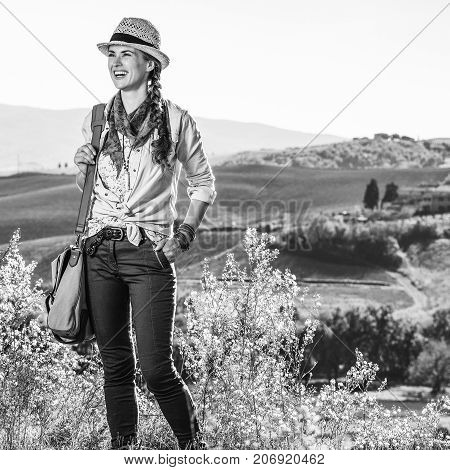 Happy Woman Hiker Enjoying Tuscany View Looking Into Distance