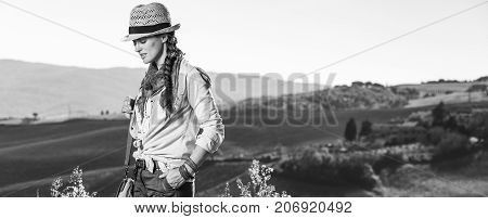 Active Woman Hiker In Hat With Bag Hiking In Tuscany