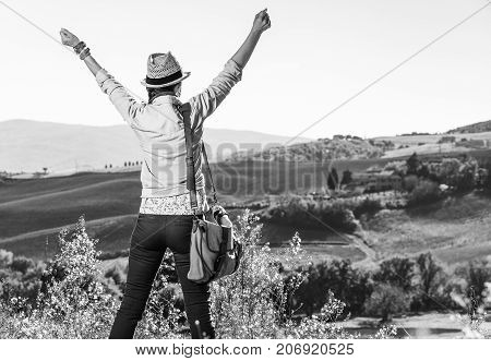 Active Woman Hiker In Hat Hiking In Tuscany Rejoicing