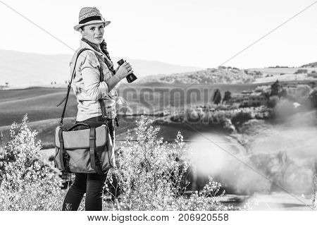 Active Woman Hiker Hiking In Tuscany With Binoculars