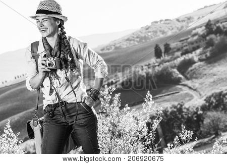 Smiling Woman Hiker On Tuscany Hike With Vintage Photo Camera