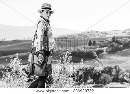 Woman Hiker Enjoying Tuscany View With Vintage Photo Camera