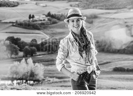 Adventure Woman Hiker In Hat Enjoying Evening In Tuscany