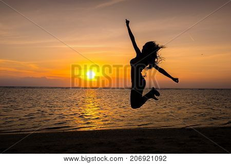 Gili Trawangan Indonesia - September 11 2017: Silhouette of Beautifull Gate with girls swing above ocean sunset. Gili Trawangan island Lombok Indonesia