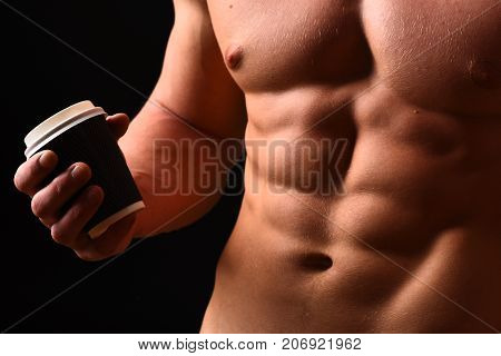 Athletes Body In Close Up, Hand Holding Coffee Cup