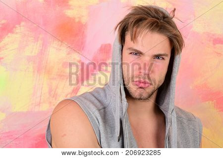 Man With Bristle And Blue Eyes. Guy Wears Sleeveless Hoodie