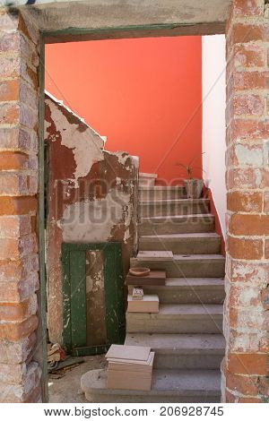 Concrete staircase in brick building for restoration