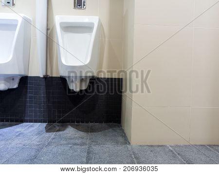 toilet men's room.Close up row of outdoor urinals men public toilet Urinals in the men's bathroom urinals design