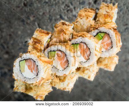 Bonito roll with salmon, avocado and cream cheese